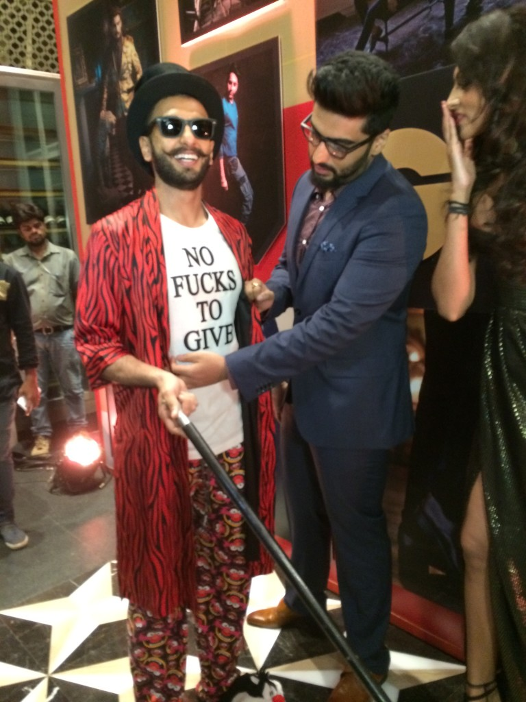 In walked Arjun Kapoor, who seemed to be tickled pink with his buddy Ranveer's statement tee.