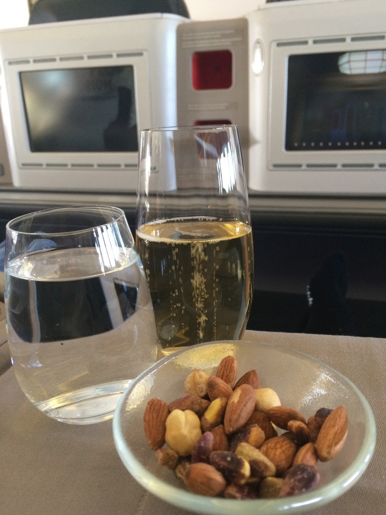 As an aperitif, I choose champagne with sparkling water, which is served with warm nuts.
