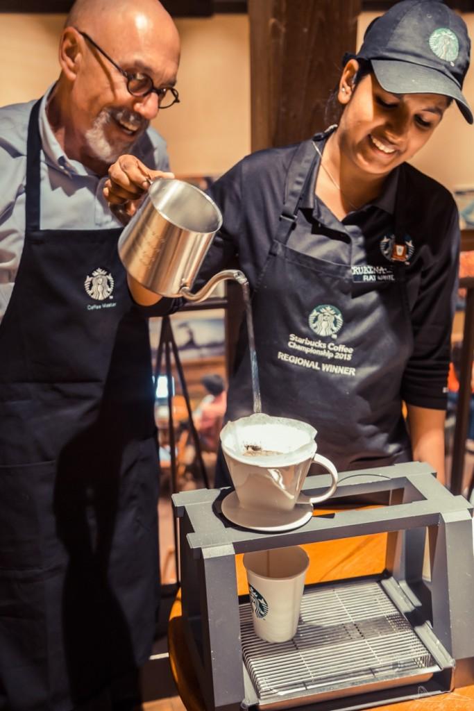 Rubina slowly pours warm water on the coffee powder