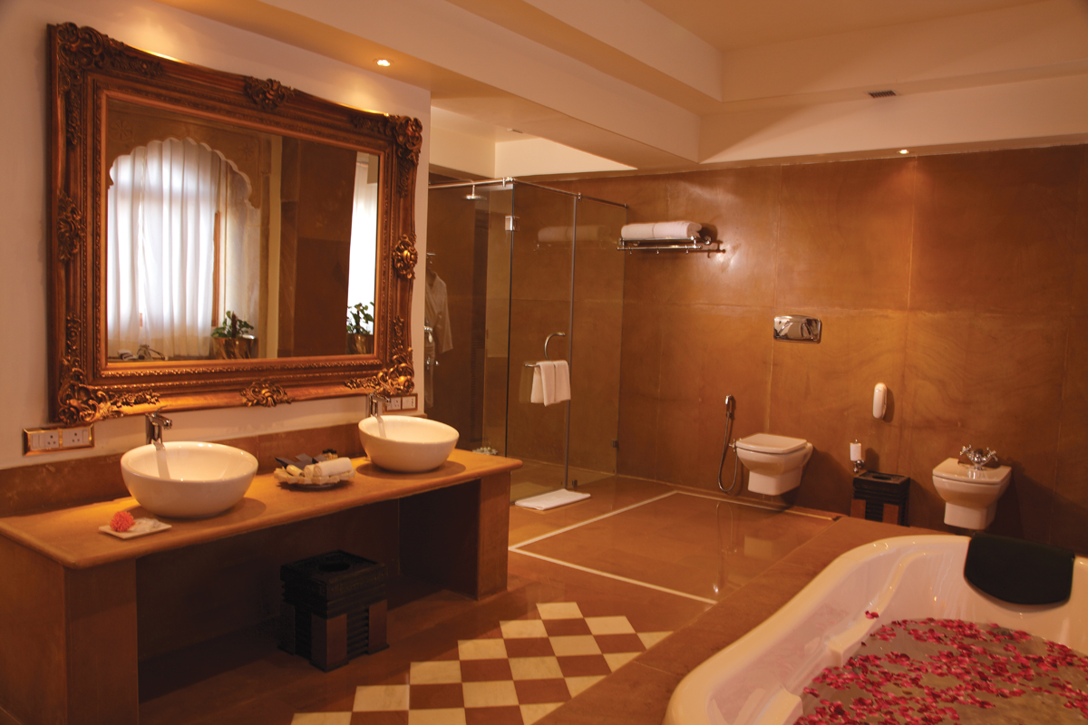 Under rajasthan 39 s desert sky hotel suryagarh jaisalmer for Bedroom designs with attached bathroom and dressing room